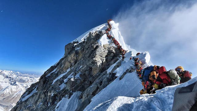 Climbers wait in line to reach the peak of Mount Everest