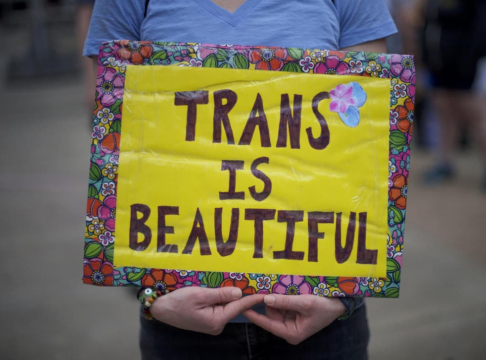 Protestors demonstrate during a rally against the transgender bathroom rights repeal at Thomas Paine Plaza 15 February 2017 in Philadelphia, Pennsylvania