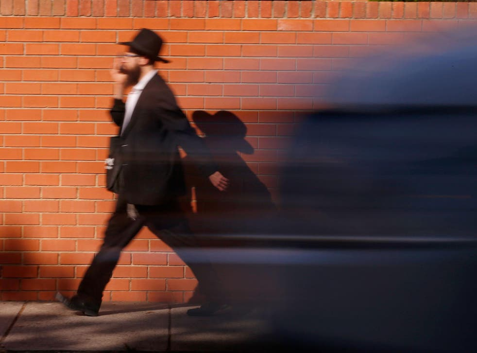 An Orthodox Jewish man walks along Hotham Street in St Kilda East, Melbourne. Approximately 120,000 Jews live in Australia today