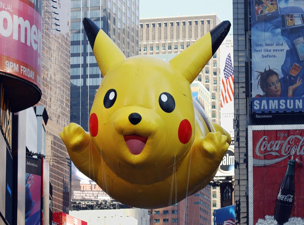 """The """"Pikachu"""" balloon sponsored by The Pokemon Company floats down Broadway during the 75th Macy's Thanksgiving Day Parade 22 November 2001 in New York"""