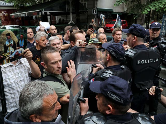 Serb ultranationalists scuffle with police during a protest in Belgrade, Serbia