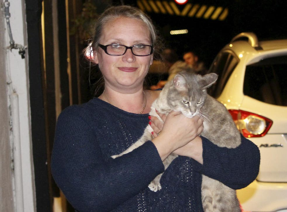 Kirsty Howden, 39, of Saltash, Cornwall, is reunited with her pet cat Hatty, who was stuck up a bridge for six days.