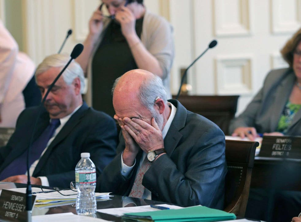 State senator David Watters pauses after the tally was announced in a vote on the death penalty at the State House in Concord, New Hampshire