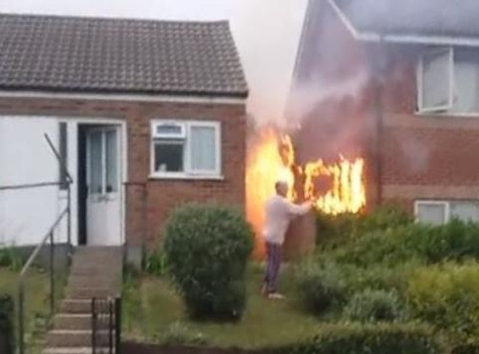 Neighbours blame each other for fence fire in Chatham, Kent