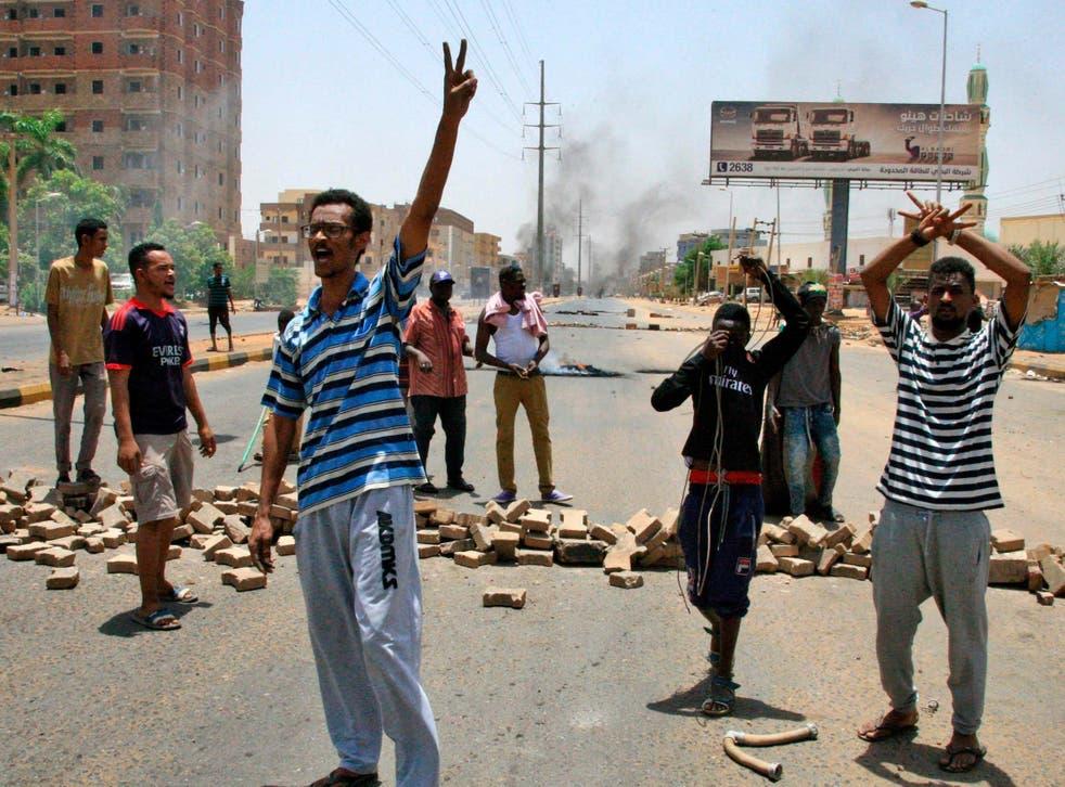 Protesters chant slogans outside Khartoum's army headquarters