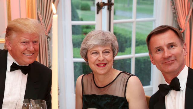 President Trump, Prime Minister Theresa May and Jeremy Hunt, the foreign secretary, pose for a photo during dinner at Winfield House, the US ambassador's residence in London