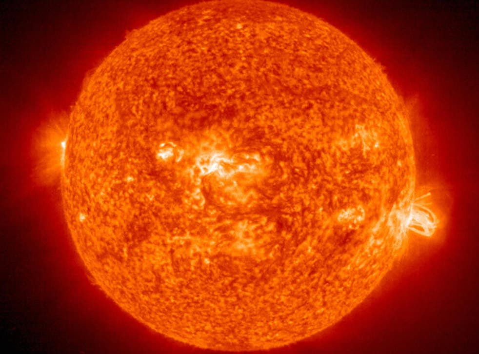 A solar flare erupts from a giant sunspot