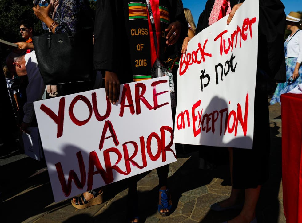 Stanford students carried signs in solidarity with the Stanford sexual assault survivor known as Emily Doe during graduation ceremonies at Stanford University in Palo Alto, California, on 12 June, 2016.