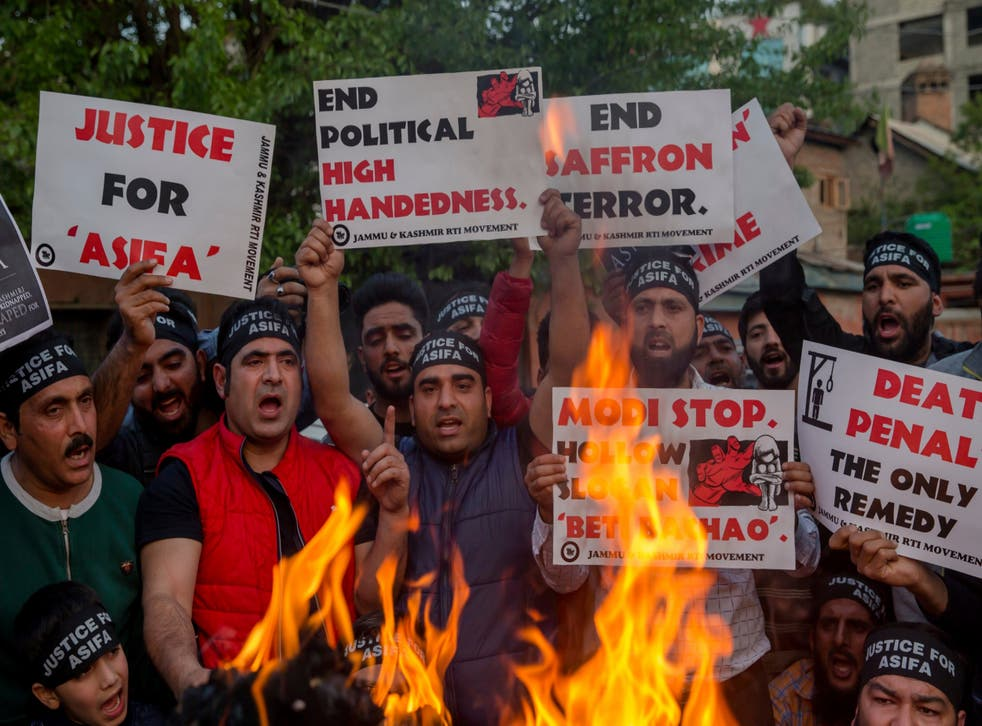 Kashmiri activists hold torches and march in a protest against the rape and murder of an 8-year-old girl, in Srinagar, Indian controlled Kashmir