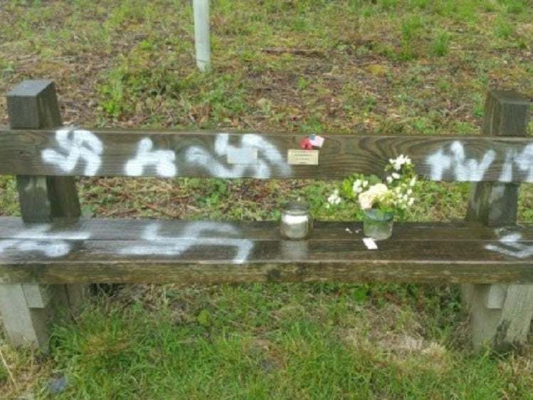 Swastikas spray-painted across commemorative D-Day bench, say police