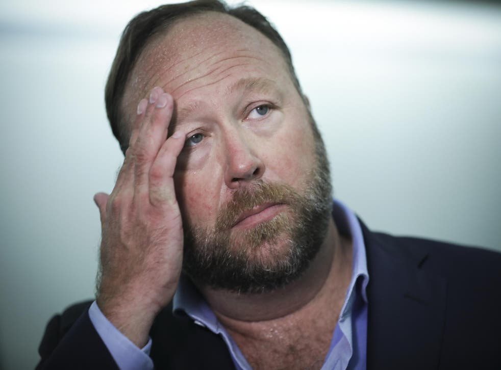Alex Jones' (above) conspiracy site Infowars to pay $15,000 settlement in copyright dispute over Pepe the Frog cartoon