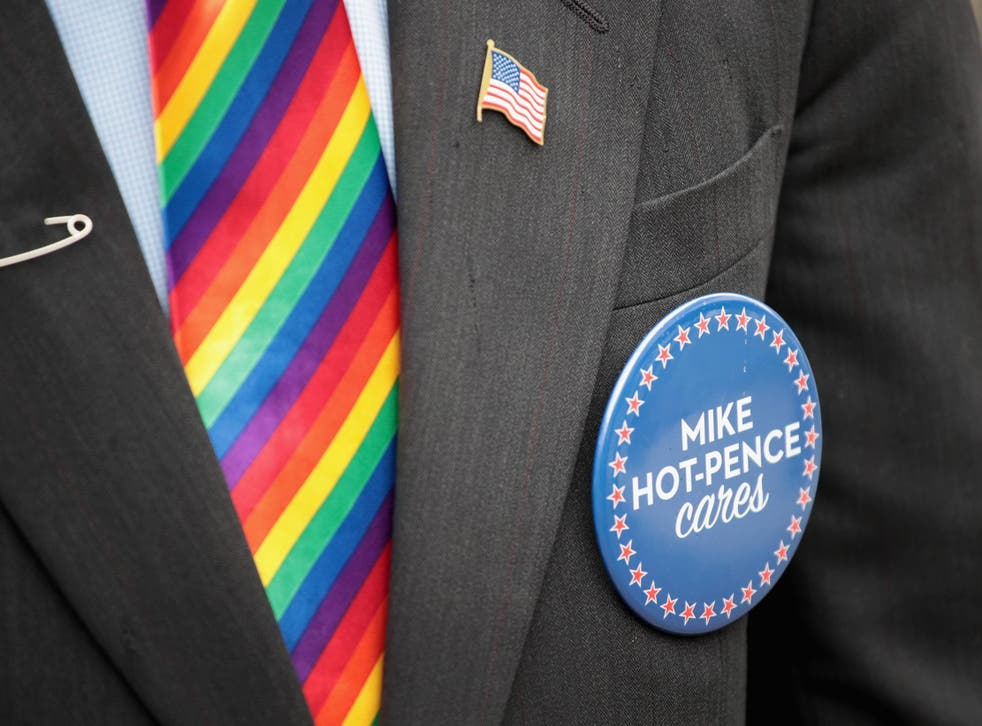 Mike Pence (represented above by look-alike Mike-Hot-Pence) has defended US government's decision to bar rainbow flags outside US embassies