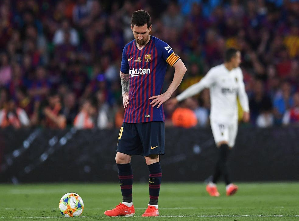 Lionel Messi of FC Barcelona shows his dejection after Rodrigo Moreno of Valencia CF scored his team's second goal during the Spanish Copa del Rey match