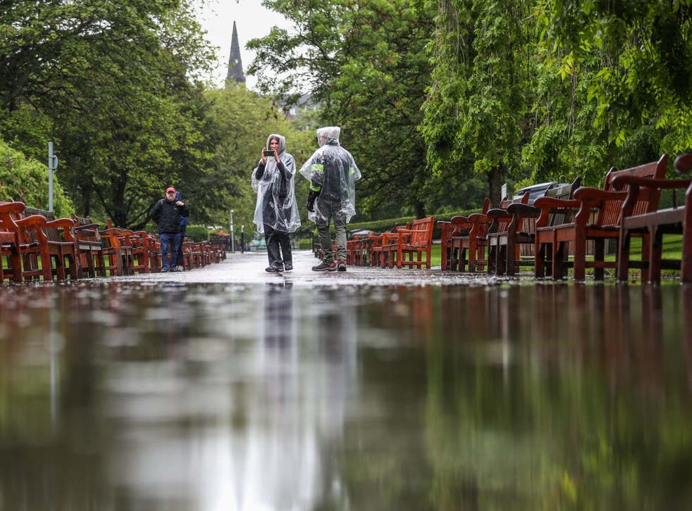 A flooded footpath in Edinburgh's Princes Street Gardens; the downpours caught many tourists by surprise