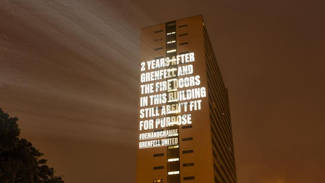 Campaign group Grenfell United project a message on to the side of a tower block in Newcastle ahead of the second anniversary of the Grenfell fire to highlight the number of blocks that are still covered in flammable cladding, despite the role that it played in the fire