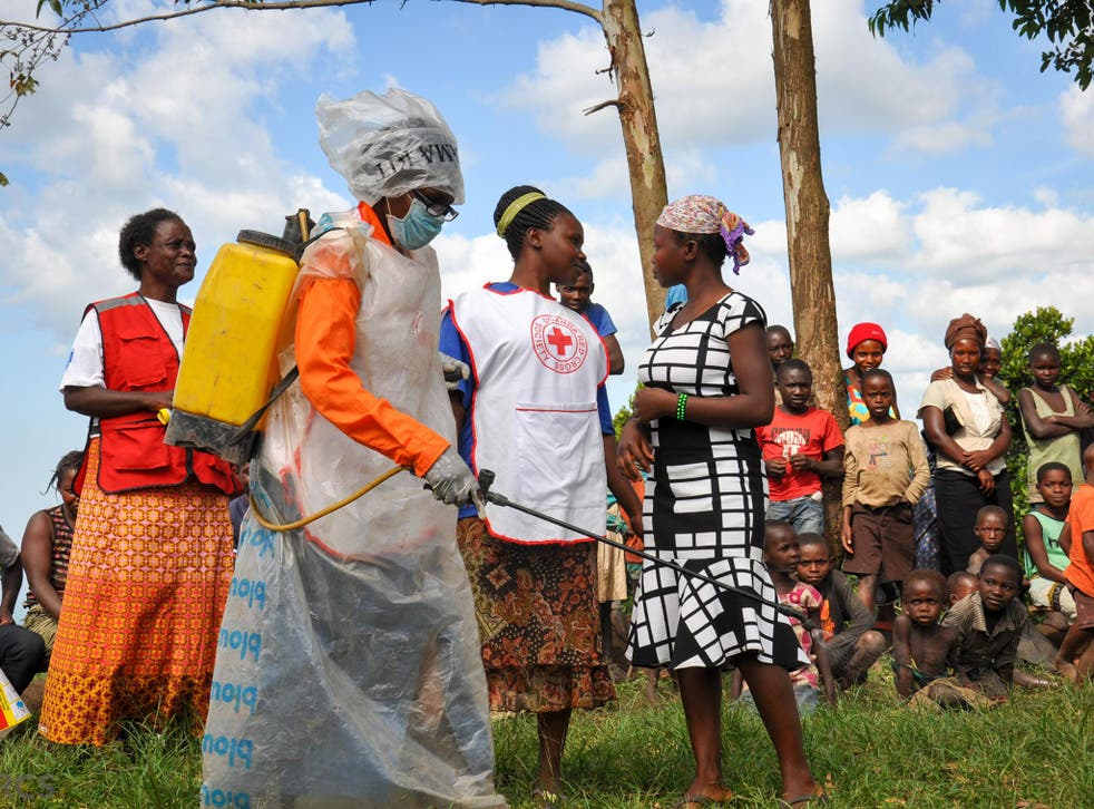 A scene from a play portraying the safe and dignified burial process. Uganda Red Cross uses theatre in communities to disseminate critical information about Ebola