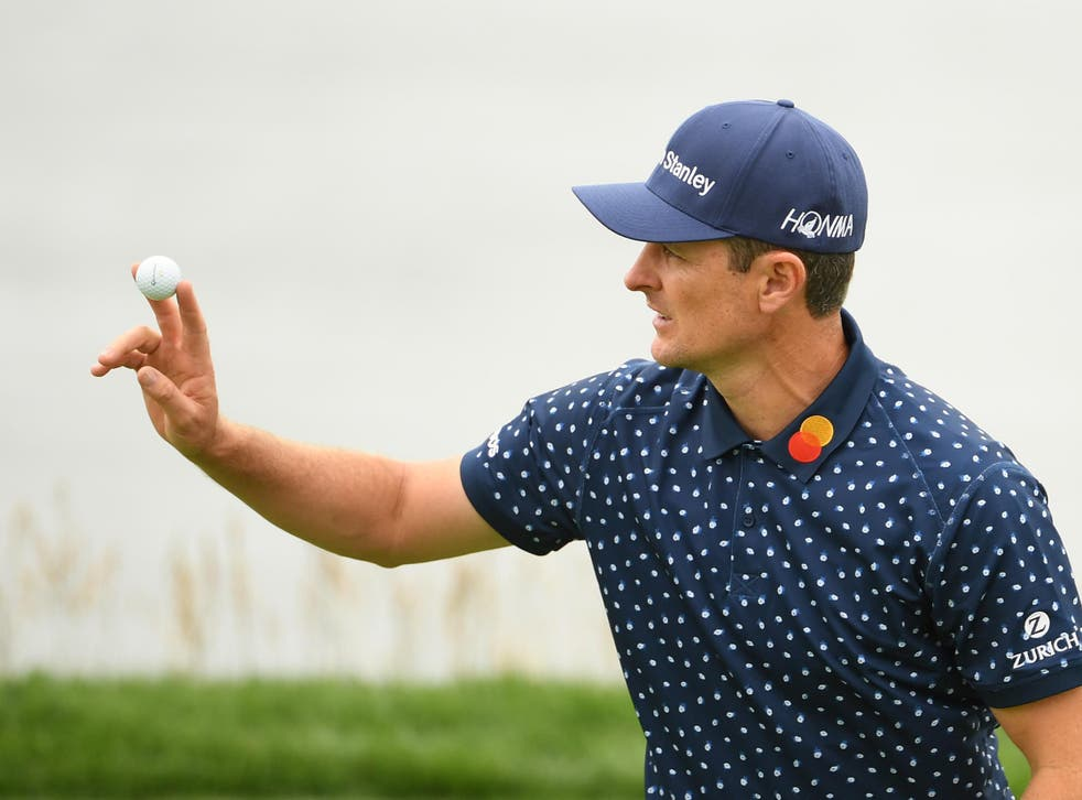 Justin Rose acknowledges the crowds on the eighth green