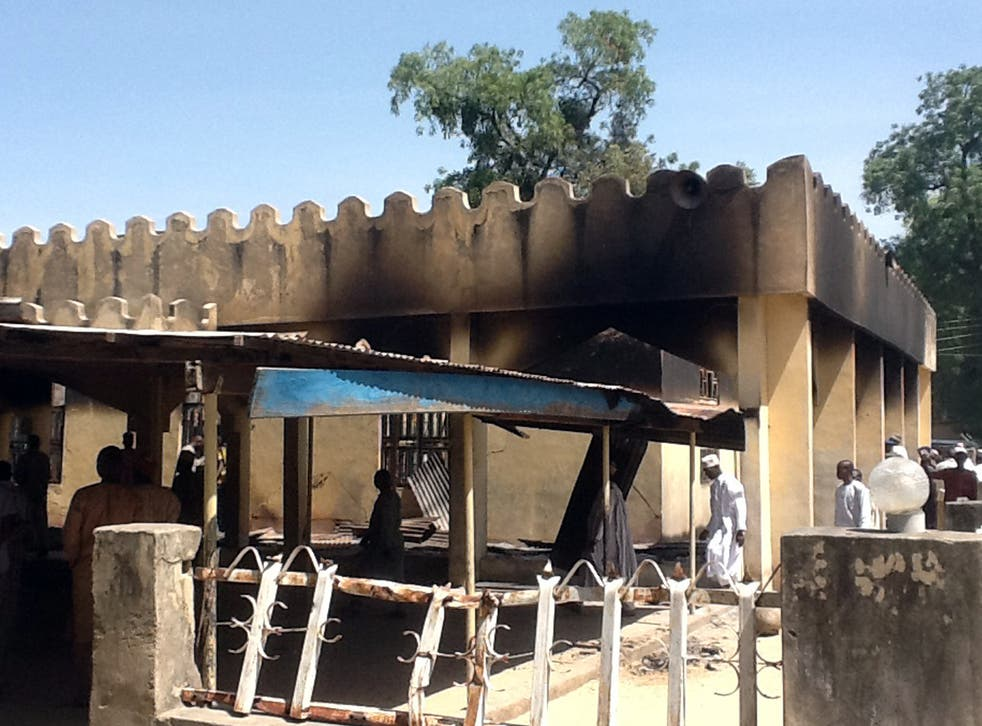 People in Konduga following a 2014 bombing. The village has been attacked multiple times