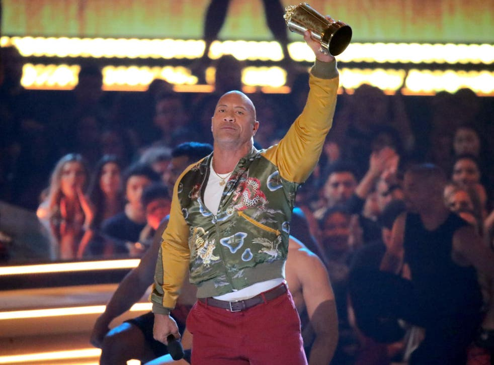 Dwayne 'The Rock' Johnson holds up his Generation Award at the MTV Awards 2019