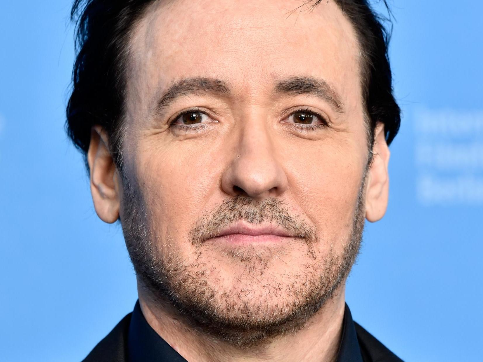 John Cusack attacked by police and 'hit by pepper spray' while filming Chicago protests