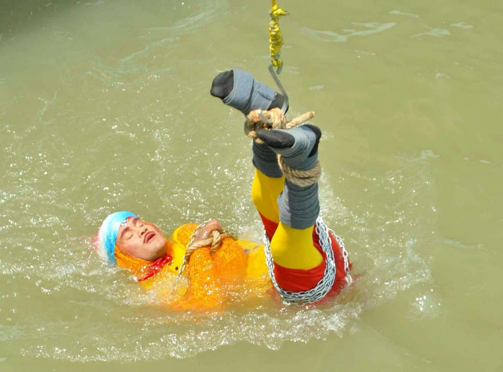 Chanchal Lahiri lowered into the Hooghly river shortly before his death