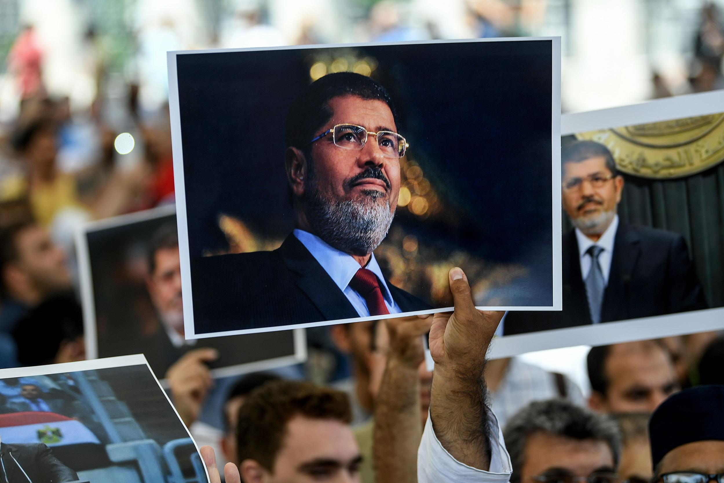 Egyptian democracy died yesterday in a prison cage alongside Morsi