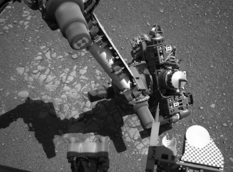 The image from Curiosity's left navcam at the same time shows the craft was attempting to take a self-portrait over the Martian terrain