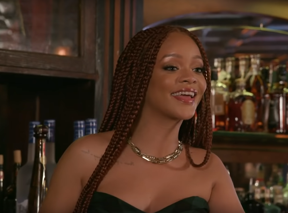 Rihanna goes behind the bar during the late night talk show segment