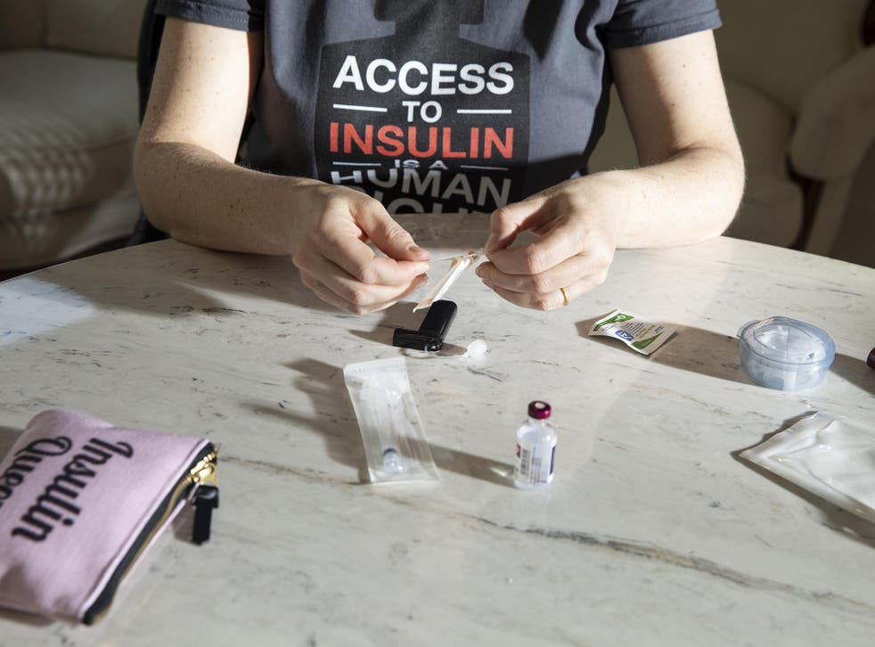 Lija Greenseid prepares to draw insulin at her Minnesota home for her daughter who has type 1 diabetes