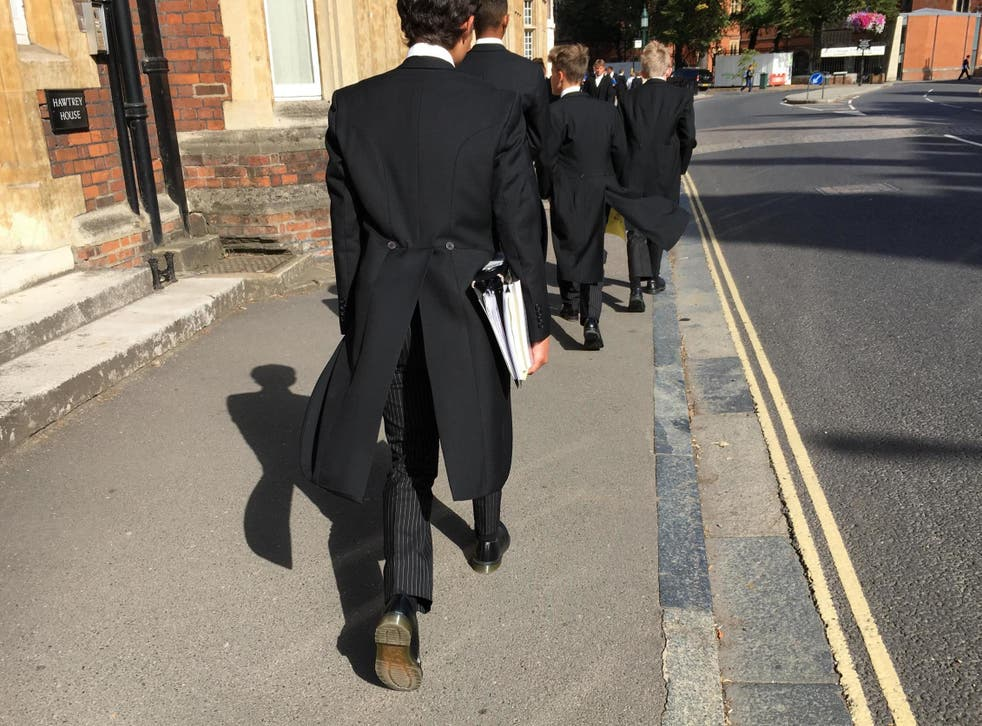 Tails you win: Eton schoolboys in their traditional uniform