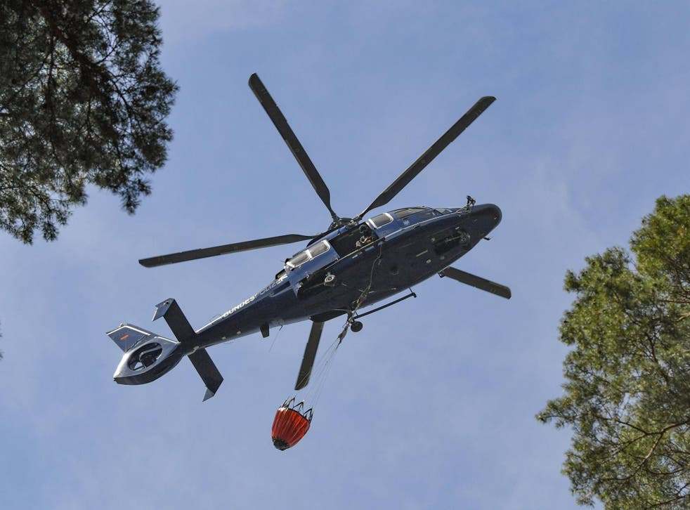 Helicopter collects water in eastern Germany