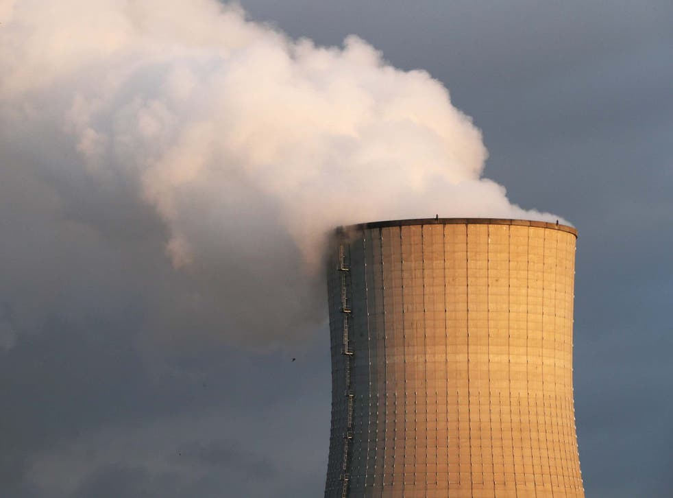 Smoke billows from a chimney at a combined-cycle gas turbine power plant