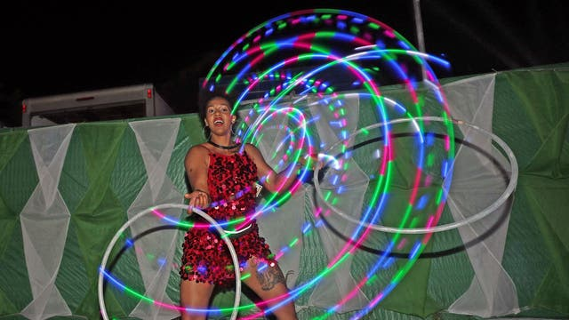 A woman dances with LED hula hoops on the second day of Glastonbury Festival