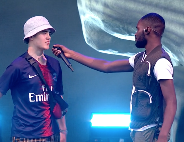 Rapper Dave (right) with fan Alex on the Other Stage at Glastonbury