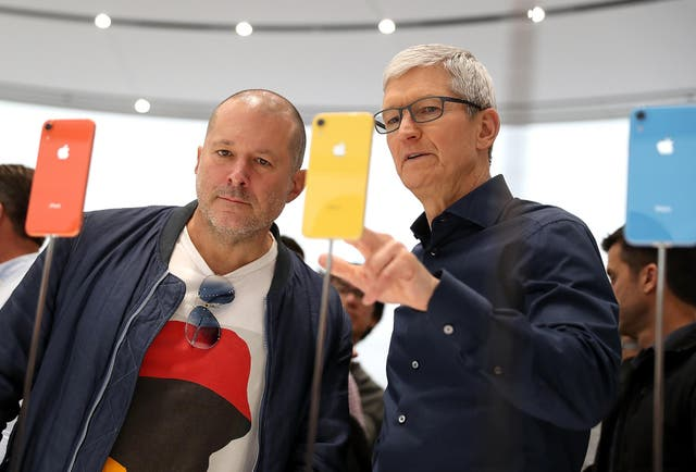 Apple CEO Tim Cook speaks to Jony Ive during an Apple special event at the Steve Jobs Theatre