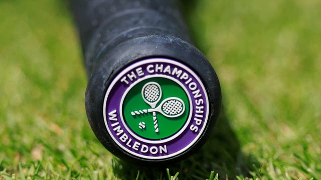 General view of the Wimbledon logo on the base of a tennis racquet