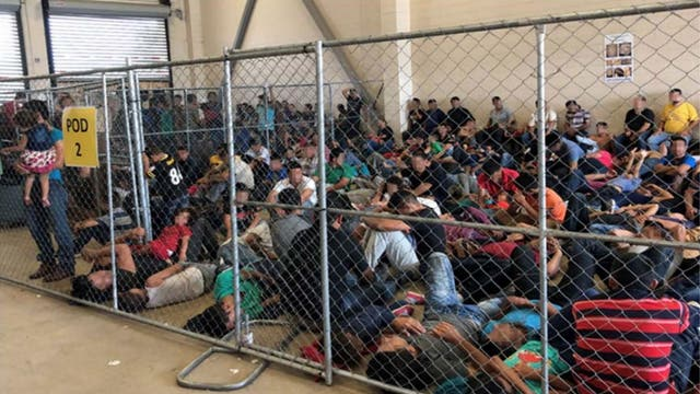 """Photos of detained migrants crowded into cells at the US border - with one holding up a sign reading simply """"help"""" - have been released as part of a new report warning of """"dangerous"""" overcrowding. The memo was sent to the Department of Homeland Security by its Inspector General, containing photos taken at border facilities in the Rio Grande Valley over a week in June"""
