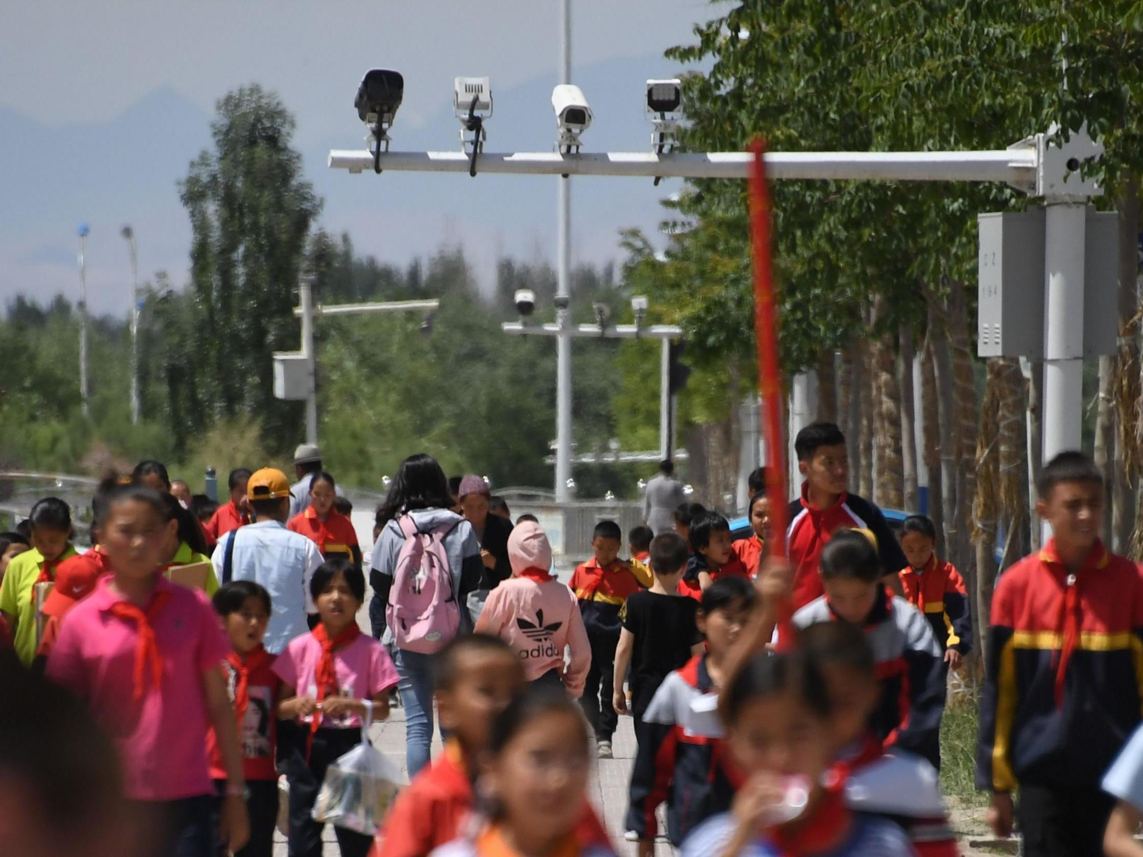 China Snares Tourists' Phones in Surveillance Dragnet by
