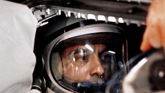 """US astronaut Alan B Shepard Jr sitting in his Freedom 7 Mercury capsule, ready for launch on 5 May 1961. Just 23 days earlier, Soviet cosmonaut Yuri Gagarin had become the first man in space. After several delays and more than four hours in the capsule, Shepard was ready to go, and he famously urged mission controllers to """"fix your little problem and light this candle""""."""