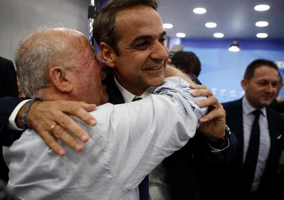 New Democracy leader Kyriakos Mitsotakis hugs supporters following election win