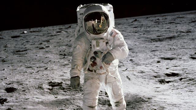 Buzz Aldrin walks on the moon in an image taken by Apollo 11 commander Neil Armstrong.