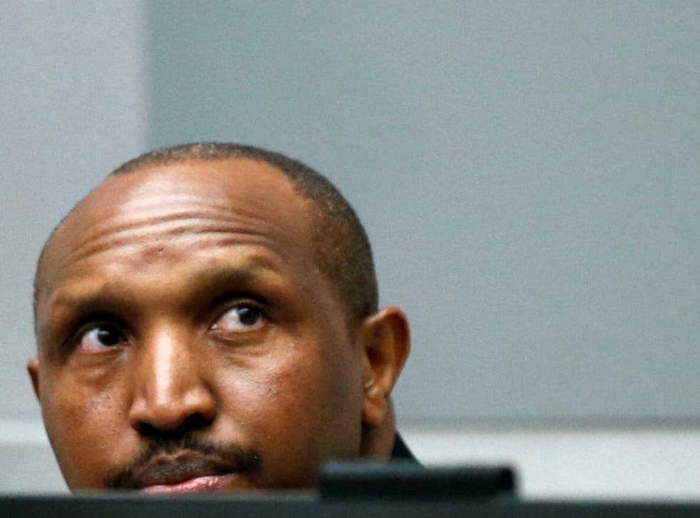 Bosco Ntaganda sits in the ICC's courtroom earlier today