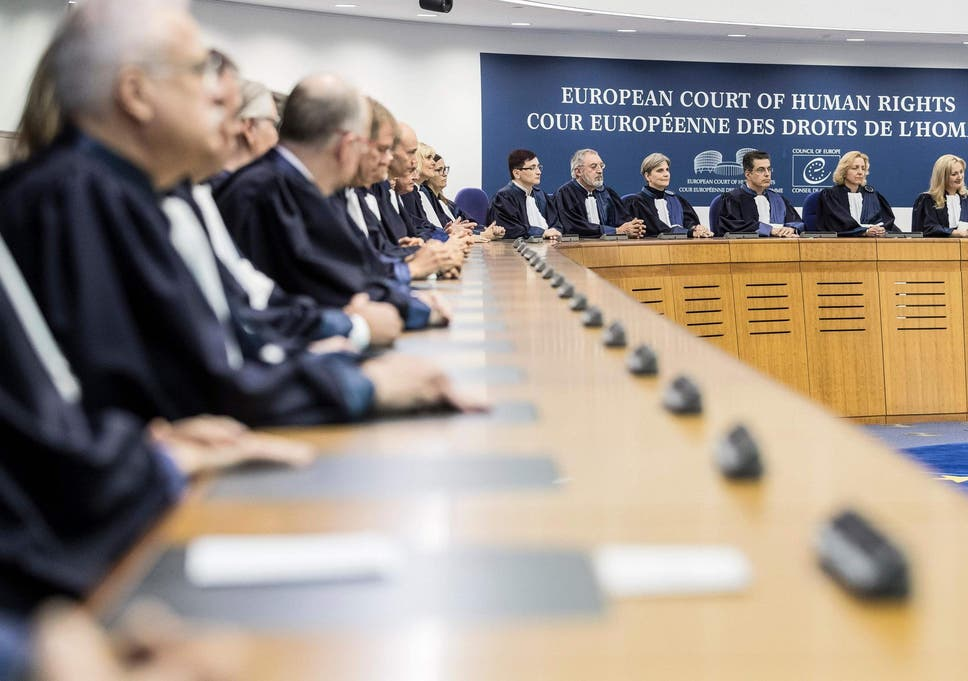 Judges of the European Court of Human Rights listen in Strasbourg