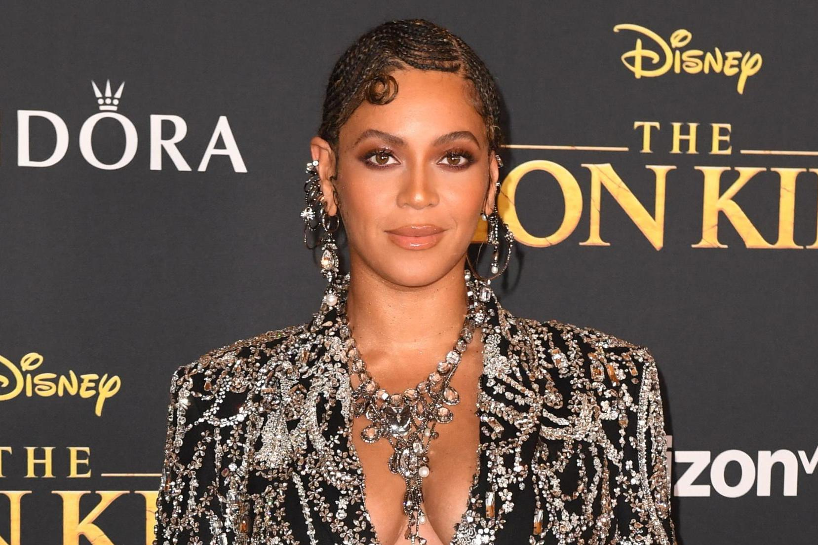 Beyoncé wears bejewelled Alexander McQueen blazer mini dress at Lion King premiere