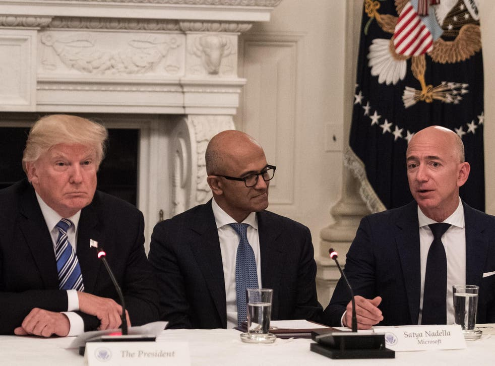 US President Donald Trump and Microsoft CEO Satya Nadella listen to Amazon CEO Jeff Bezos during an American Technology Council roundtable at the White House in Washington, DC, on 19 June 19, 2017