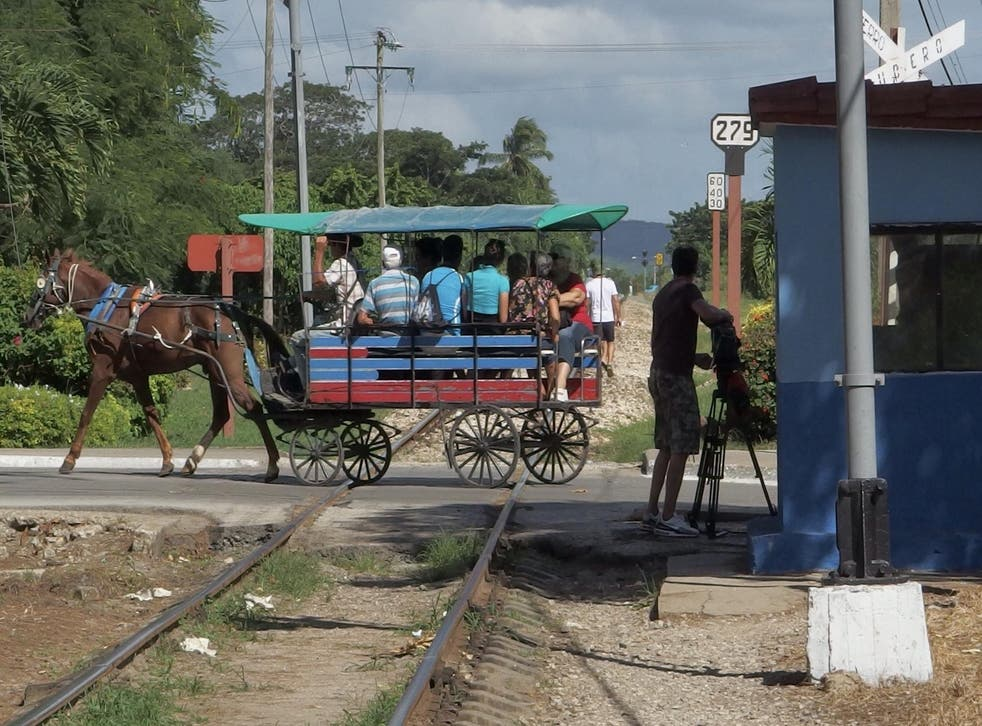 The horse-drawn buses crossing the track in the central city of Santa Clara look plausibly faster than the trains that ply the length of the island