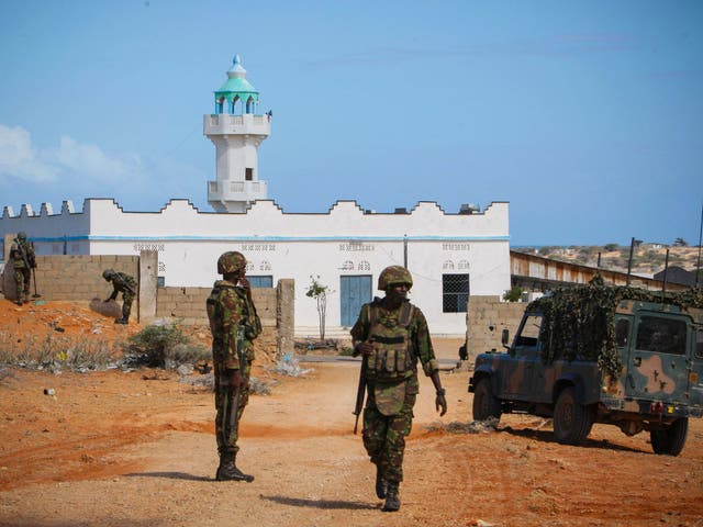 Troops from the African Union Mission in Somalia patrol in the port city of Kismayo, where the attack took place