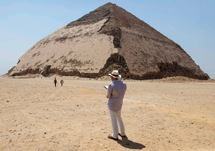 A man stands in front of the bent pyramid of Sneferu, in Dahshur, south of Cairo, in Egypt, which was opened to the public on 13 July, 2019.