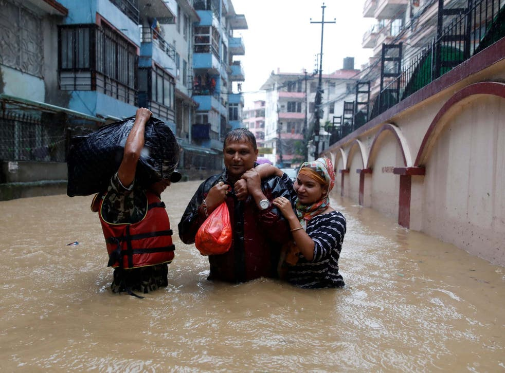 Homes in Nepal have been submerged in flood waters after monsoon rains pounded the country