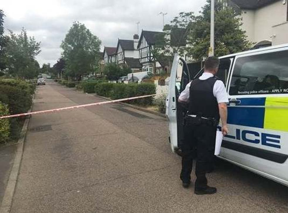 Police in Malvern Drive, Woodford Green, northeast London, where 41-year-old Paul Allen was shot